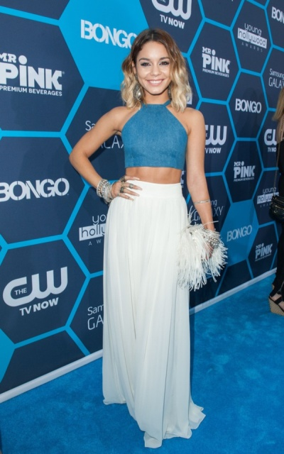 With white maxi skirt and unique clutch