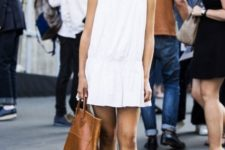 With white mini dress and brown leather flat sandals