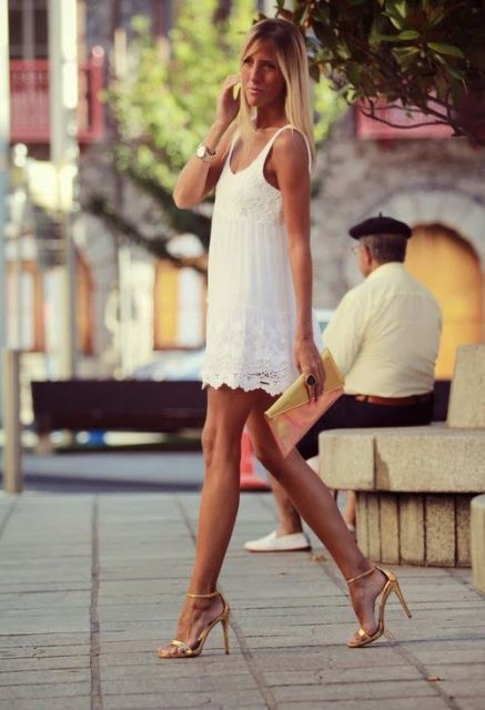 With white mini dress and clutch