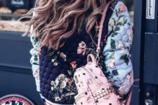 With white mini skirt and floral jacket