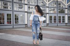 With white off the shoulder blouse, beige heels and black chain strap bag