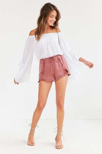 With white off the shoulder blouse, lace up sandals and chain strap bag