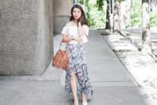 With white off the shoulder top, white pumps and brown fringe bag