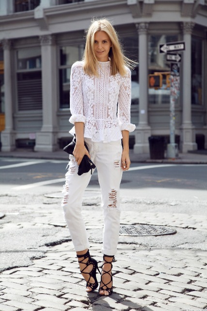 With white pants, lace up sandals and black clutch