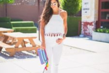 With white pants, pltaform sandals and printed clutch
