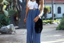 With white ruffled top, high heels and fringe bag