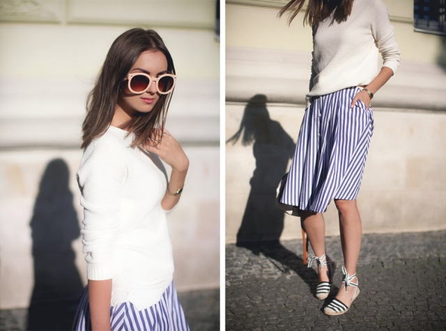 With white shirt and striped skirt