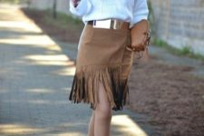 With white shirt, fringe skirt, pumps and brown bag