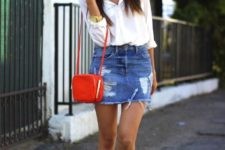 With white shirt, white sneakers and red mini bag