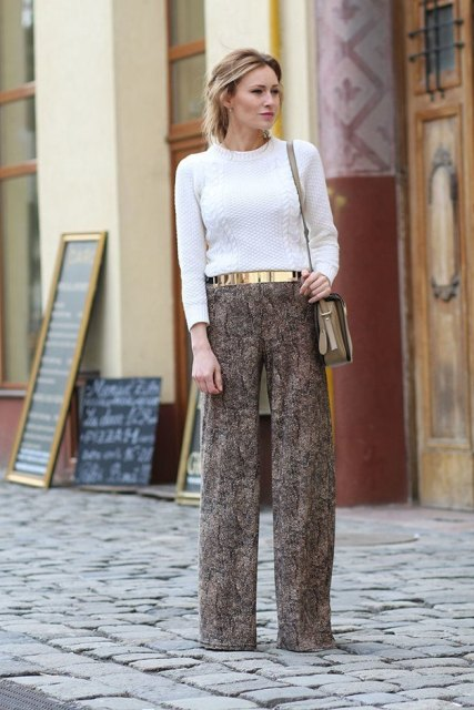 With white shirt, wide leg pants and beige bag