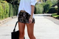 With white shirt, yellow pumps and fringe bag