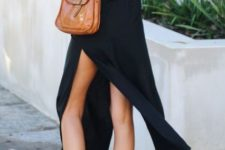 With white shoes and brown bag
