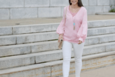 With white skinny pants, beige pumps and beige bag