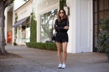 With white sneakers and black mini bag
