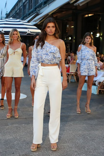 With white straight trousers and platform sandals