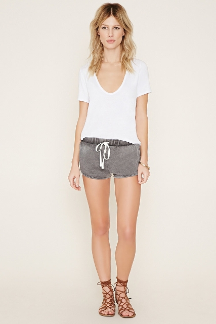 With white t-shirt and lace up sandals