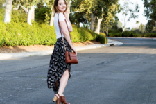 With white t-shirt, brown leather bag and brown leather sandals