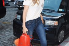 With white t-shirt, crop jeans and black flat sandals