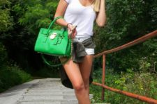 With white t-shirt, green bag and white mini shorts