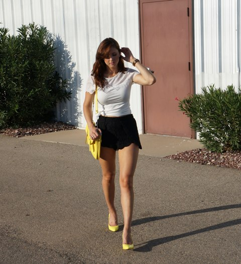 With white t-shirt, yellow pumps and yellow bag