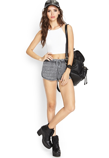 With white top, cap, platform lace up boots and black leather backpack
