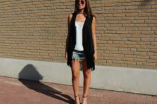With white top, denim mini shorts and black and white high heels