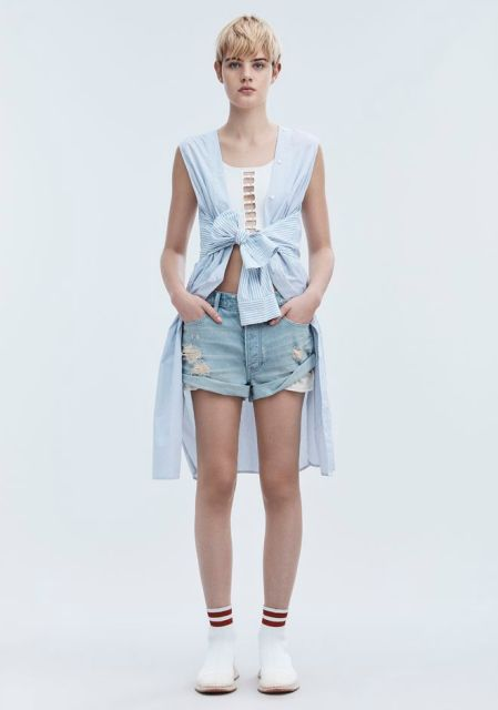 With white top, denim shorts and white shoes