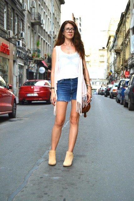 With white top, denim shorts, beige ankle boots and brown bag