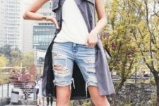 With white top, gray long vest and black shoes