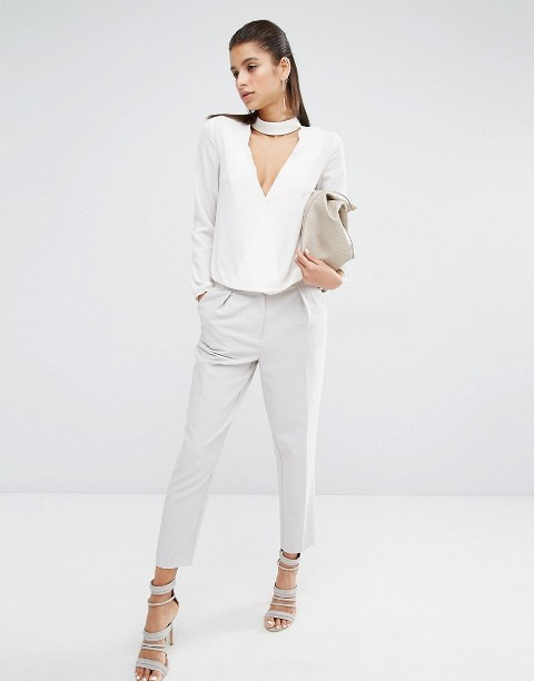 With white trousers, white sandals and beige clutch
