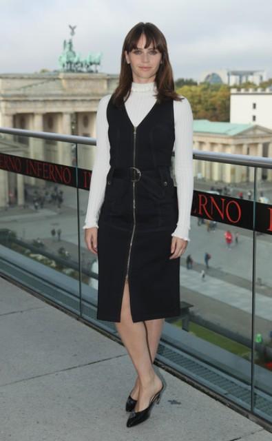 With white turtleneck and black midi dress