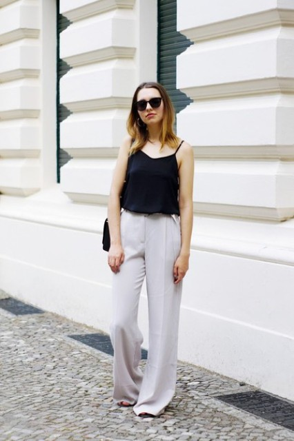 With white wide leg trousers and black bag