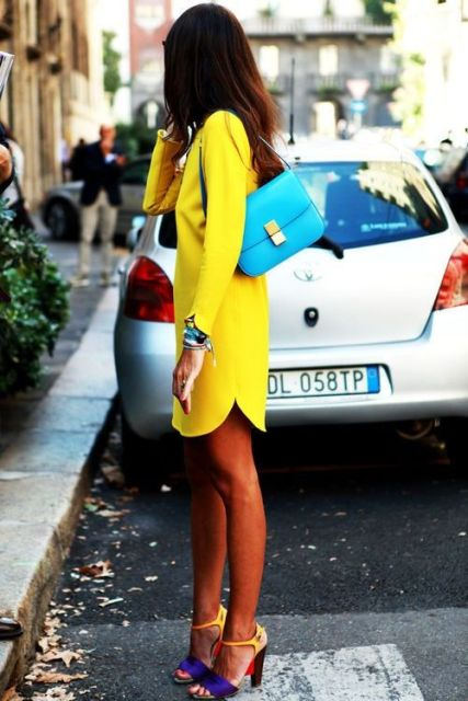 With yellow dress and blue bag