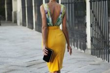 With yellow pencil skirt, white high heels and black clutch