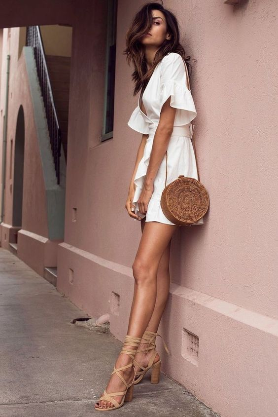 a basket round bag, tan lace up heels and a mini dress with ruffled sleeves for a sexy look