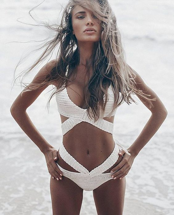 a gorgeous white crocheted one piece strappy swimsuit for a sexy look