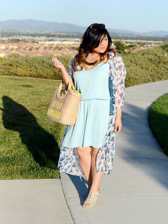 a light blue dress, a blue floral kimono, neutral shoes and a straw bag