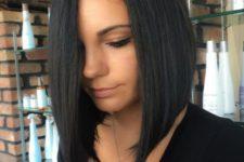 05 a black bob haircut with asymmetry and a sleek texture for a modern feel