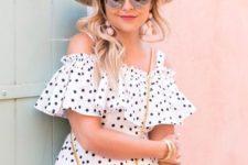 05 a polka dot cold shoulder mini dress in white and black plus a hat and a pink bag