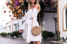 05 a white off the shoulder knee dress, tan heels, a hat and a round wicker bag