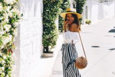 06 a white off the shoulder blouse, a striped maxi skirt, black slippers, a hat and a round wicker bag
