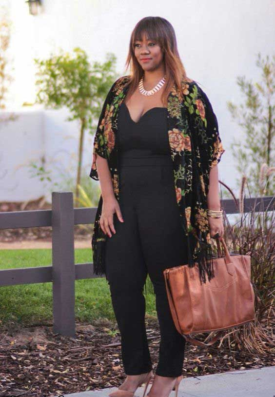 a black jumpsuit, tan shoes and a bag, a black floral kimono and a statement necklace for a special occasion