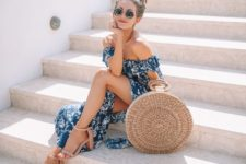 08 a blue printed off the shoulder midi dress with a slit, a round straw bag and tan shoes