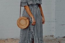 08 a striped ruffled off the shoulder dress with a front slit, tan flats and a round wicker bag