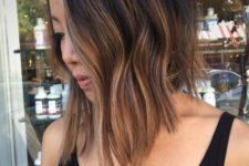 08 black to brown balayage with textural waves and asymmetry