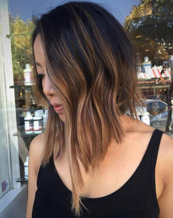 black to brown balayage with textural waves and asymmetry