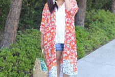 09 a white top, denim shorts, a bright floral kimono, brown heels and a straw bag for a holiday look