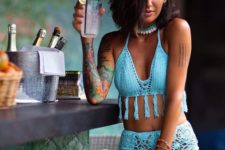 10 a blue tassel crocheted bikini with a high waisted bottom