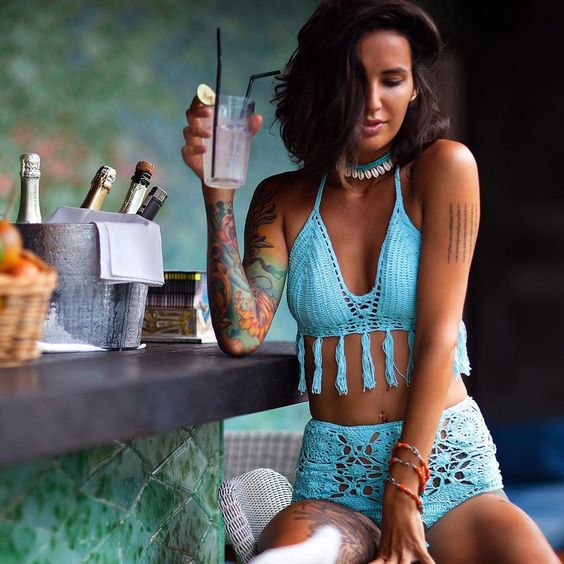 a blue tassel crocheted bikini with a high waisted bottom