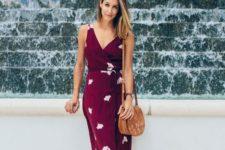 10 a plum-colored wrap dress with a slit, a V-neckline, tan mules and a bag